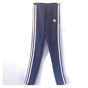 Navy blue adidas leggings with 3 stripes